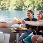 A Social Group Having a Toast by the Lake