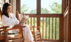 A Woman Reading the Paper on a Porch at Lake Austin