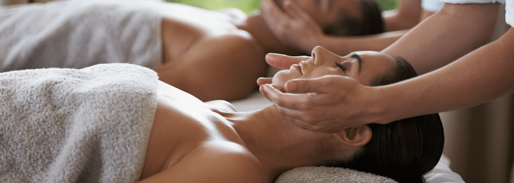 A man and woman each receive relaxing facial treatments at the Lake Austin Resort Spa.