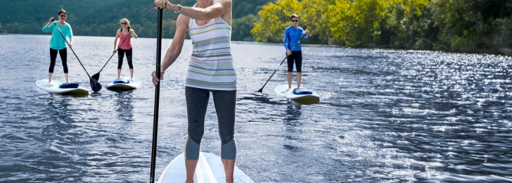 Stand Up Paddle Boarders Practicing Wellness