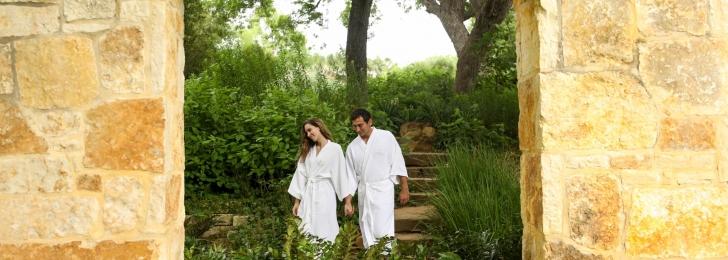 A couple strolling in Lake Austin Spa Resort