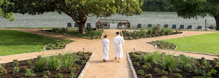couple walking on magnolia shores