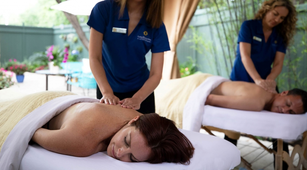 A woman and a man getting a back massage at Lake Austin Spa Resort