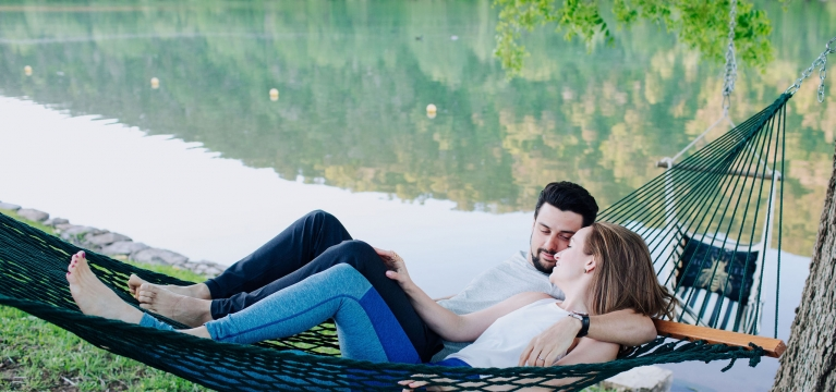 couple lounging in a hammock