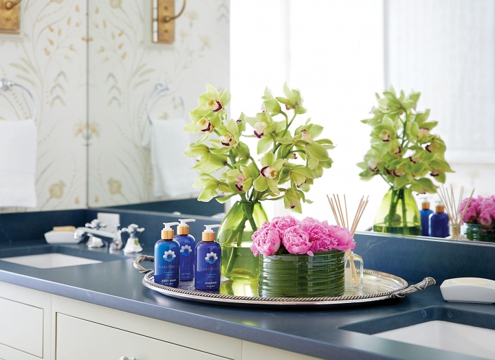Bathroom vanity with double sinks and full-size signature bath amenities in the Lady Bird Presidential Suite.