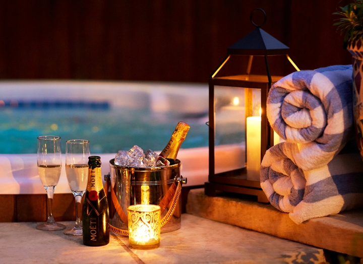 Chilled champagne beside the outdoor hot tub in the Lady Bird Presidential Suite.