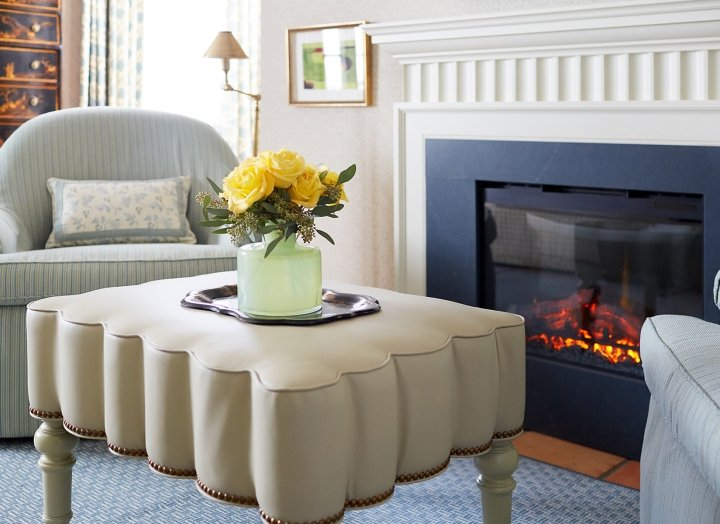 Indoor fireplace and lounge seating in the Lady Bird Presidential Suite.