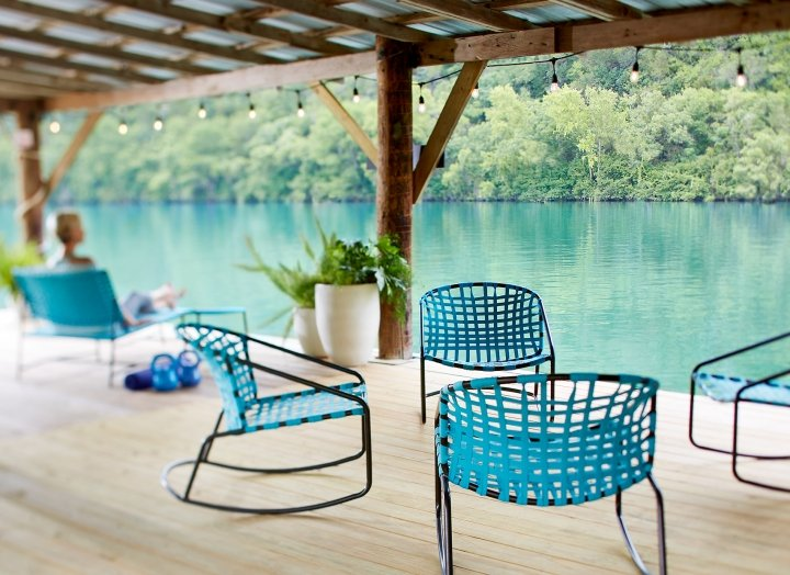 Turquoise lounge chairs gathered on the boat dock