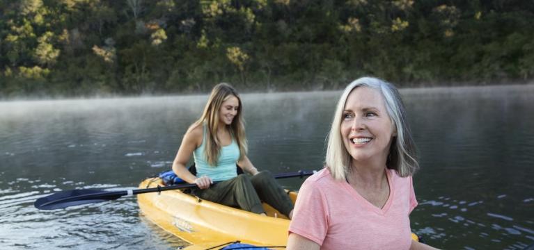 Mother and daughter kayaking at sunrise at Lake Austin Spa Resort