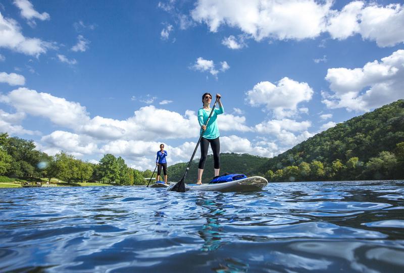 Two women on paddleboards on Lake Austin