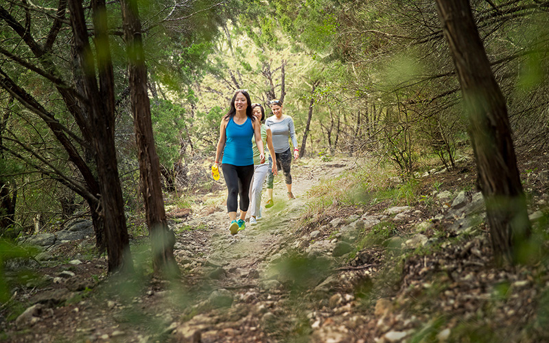 Two women hiking in the woods